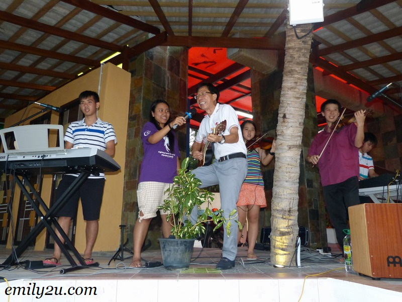 Dr Chew and his family entertaining guests