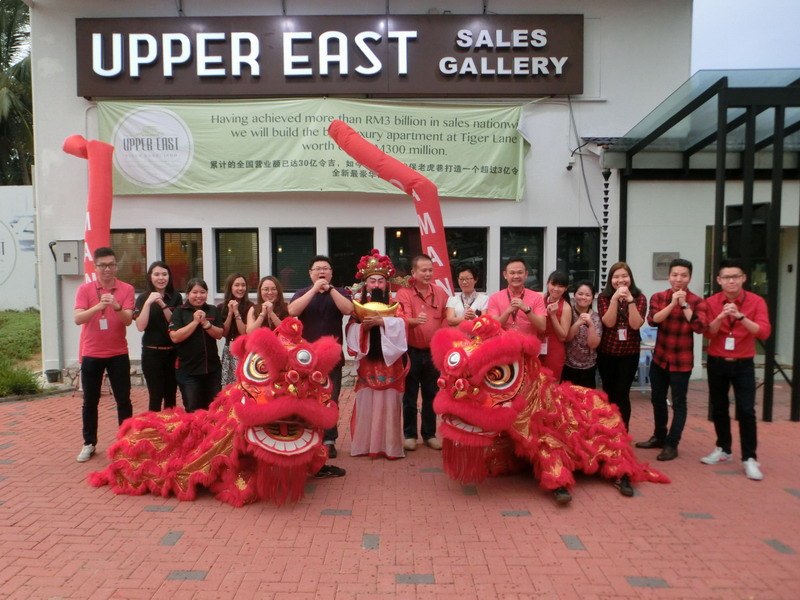 1. Upper East team with the God of Prosperity wishing everyone Gong Xi Fa Cai
