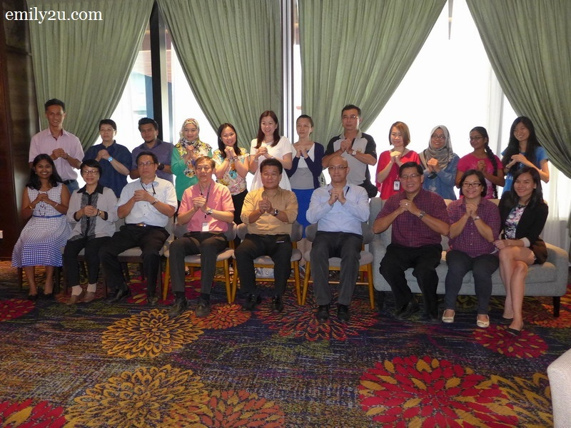 2. Ipoh Parade Centre Manager Chan Yu Yin (seated, in yellow shirt) and staff with invited guests from the media