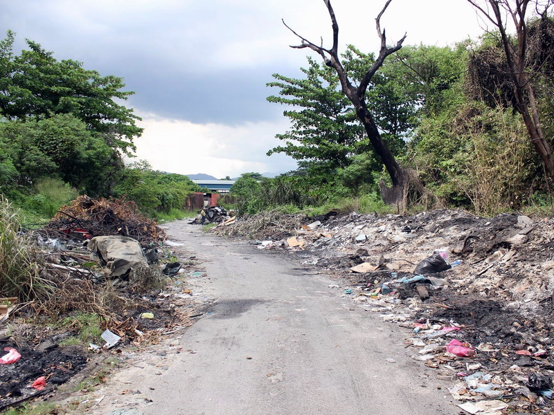2. the rubbish-strewn shortcut for residents of Kampung Pasir Putih to town