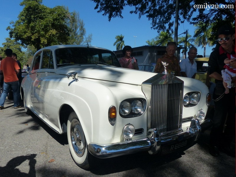 3. and a gleaming white Rolls Royce Silver Cloud
