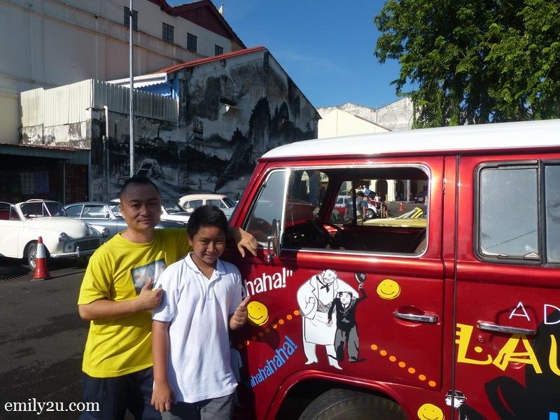 9. Au Young De Clown and his son, Peter, with their Volkswagen Kombi