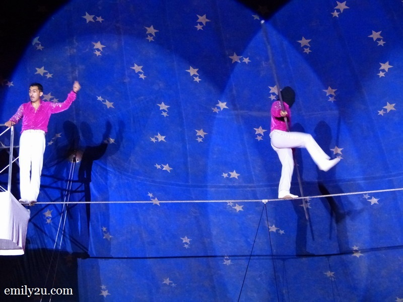 10. a blind-folded performer walks across the tightrope