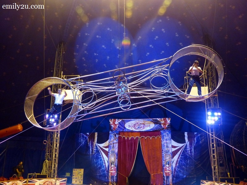 13. two circus artistes in the spinning Wheel of Death