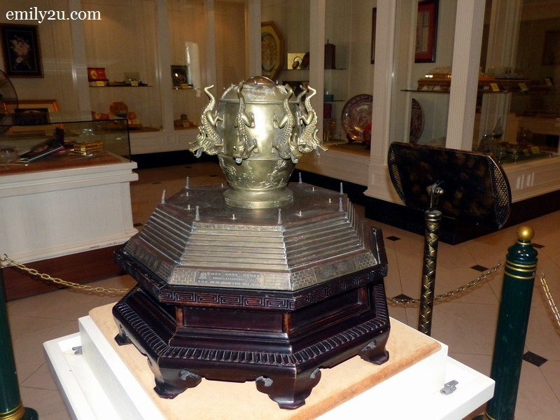 15. model of the first ancient bronze seismoscope of the world (earthquake detector) that was invented by the famous Chinese scholar, Zheng Heng, of Henan Province in 132 AD of the Han Dynasty. This model was presented to HRH as a memento on His official visit to China, 6 - 12 September, 1991.