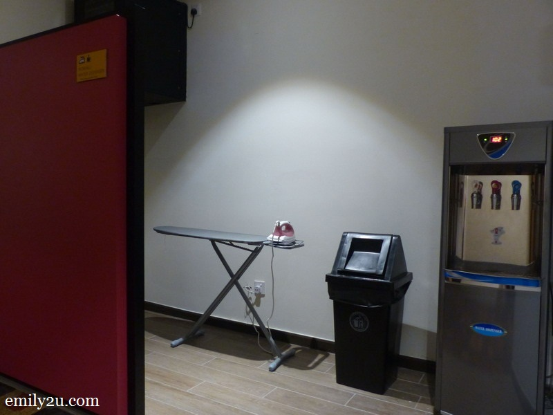 9. public ironing board and water dispenser on all floors
