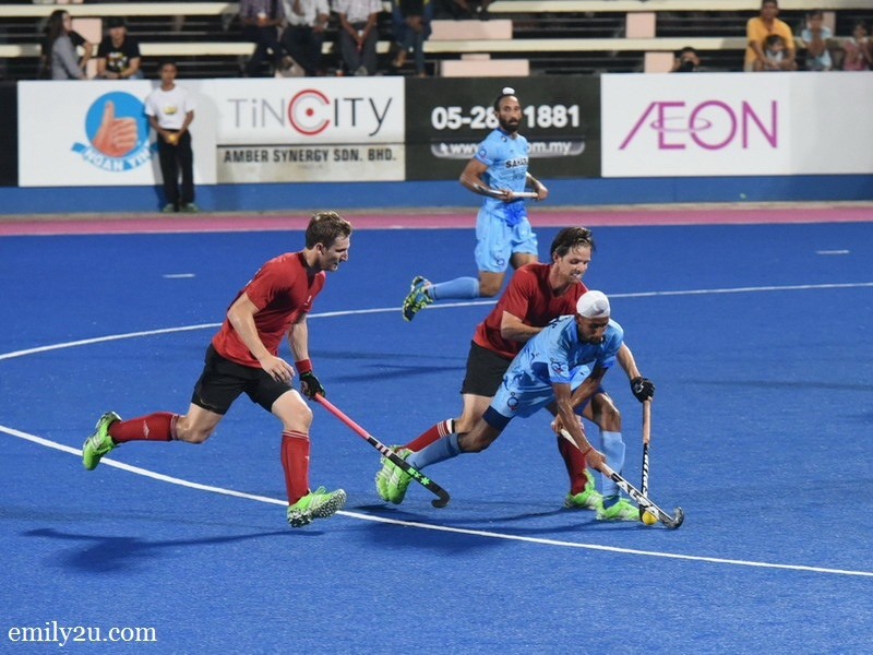 1. Canada (red / black) vs. India (blue)
