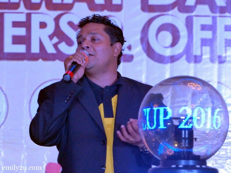 10. emcee Reuben Nagarajan entertains guests with his rendition