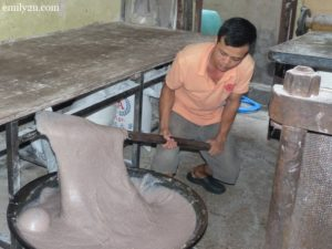 3. a worker stirs the glutinous rice mixture for two hours non-stop