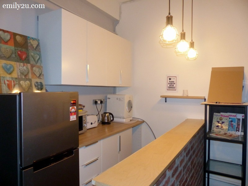 6. pantry equipped with a refrigerator, water dispenser, microwave oven and more