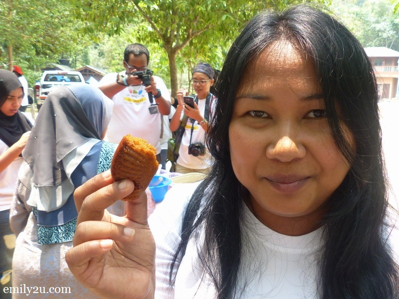 8. Marini takes a bite at a piece of Apam Gula Hangus