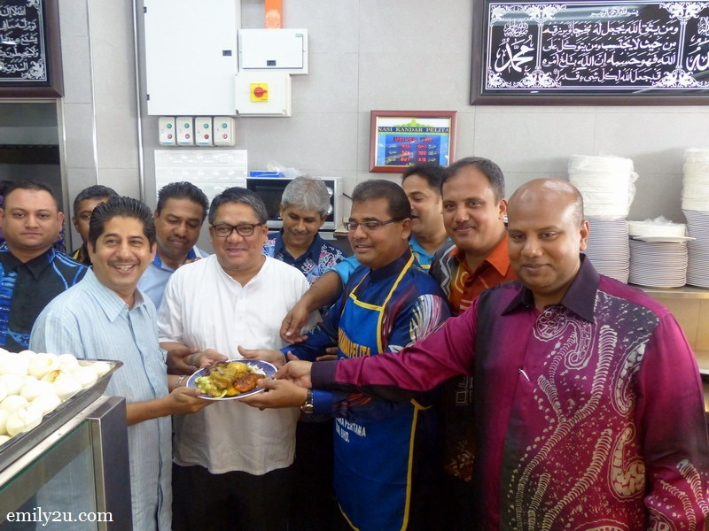 1. Executive Chairman of Nasi Kandar Pelita Sdn. Bhd. Dato' Shamsuri Bin Ahmad (in white) and directors of the company serve their famous nasi kandar