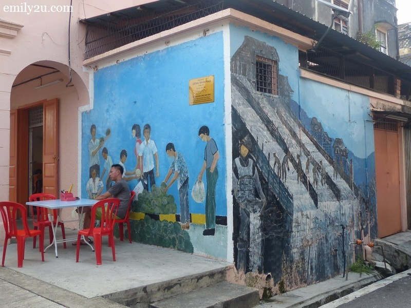 13. two different murals at the back of a coffee shop
