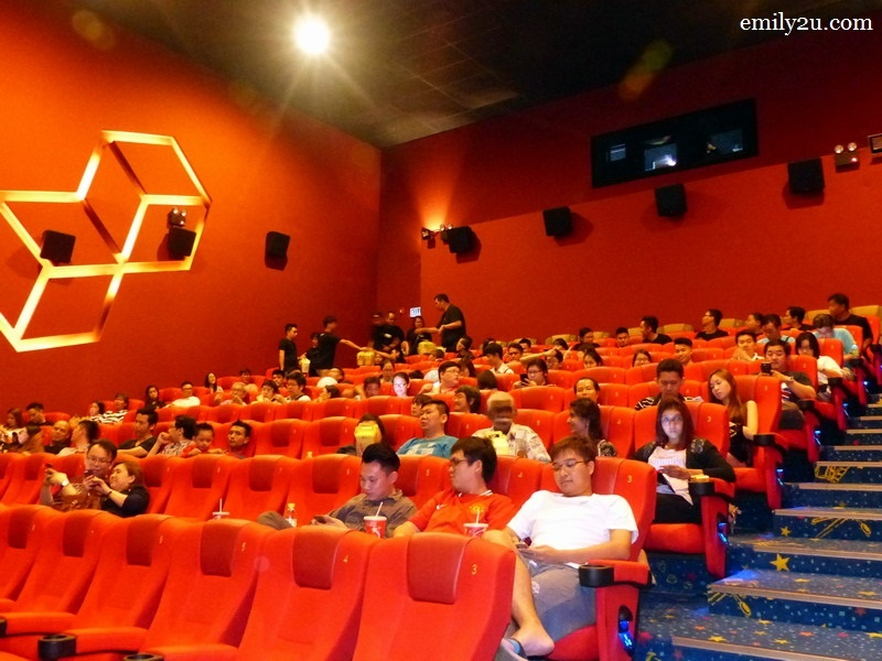 6. Honorians wait for the movie to commence