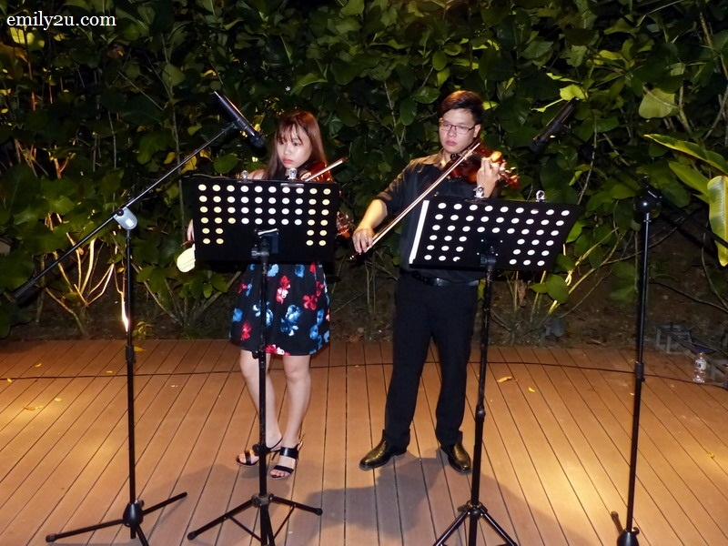 8. a couple of violinists, Ms. Soo and Ken, serenade guests with classical numbers throughout the evening