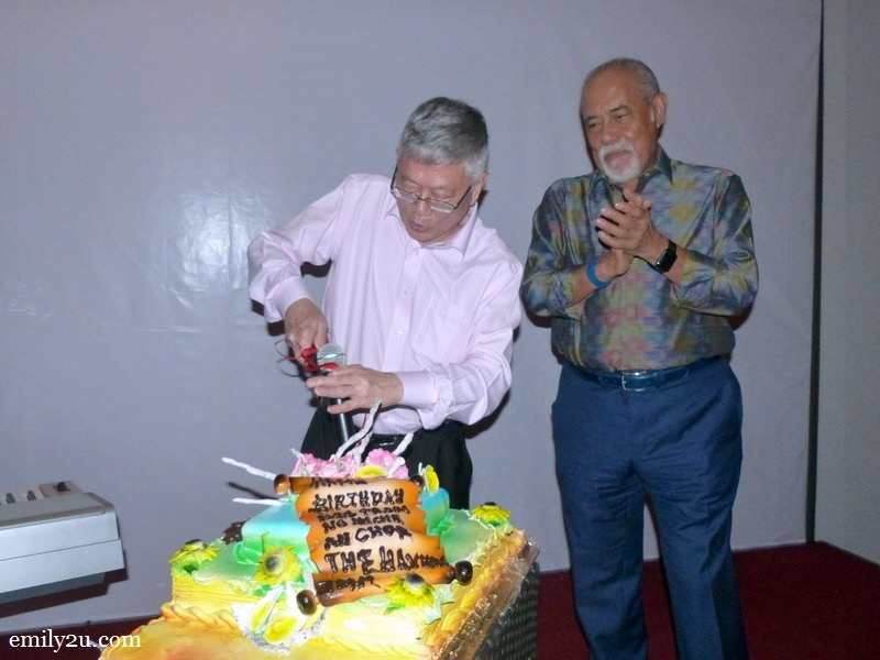 10. Mr. Peter Chan cuts his birthday cake as Tan Sri Dato' Seri Haji Megat Najmuddin (R) looks on. The cake was baked by The Haven's pastry chef Emiey.