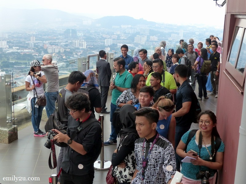 4. visitors wait at the Sky Deck for their turn to take photos in the Skybox