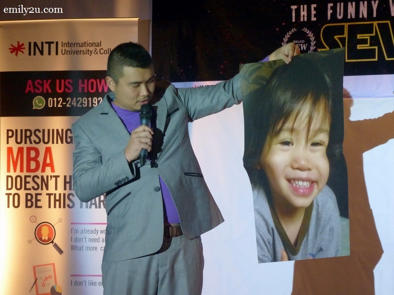 3. Phoon Chi Ho with a poster of his 3-year-old son, Tristan