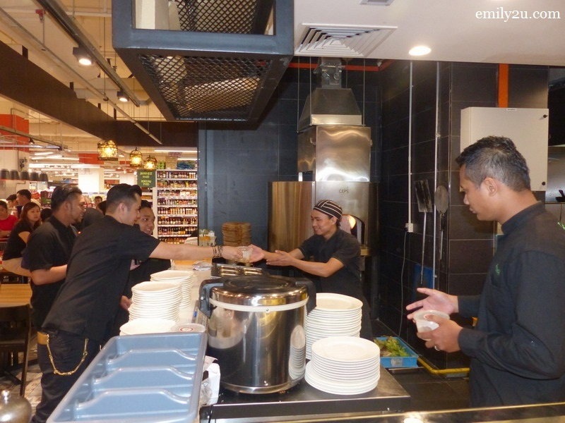 5. Dato Fazley distributes his Caramelized Banana to the crew of Fresco Grocerant