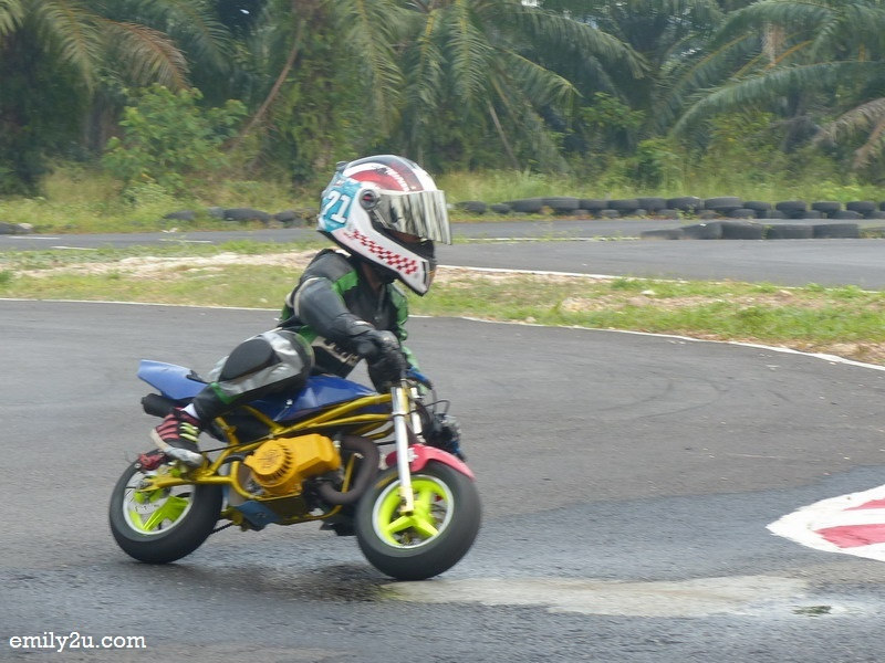 5. 9-year-old Mohd Jehan Irfan on his pocket bike