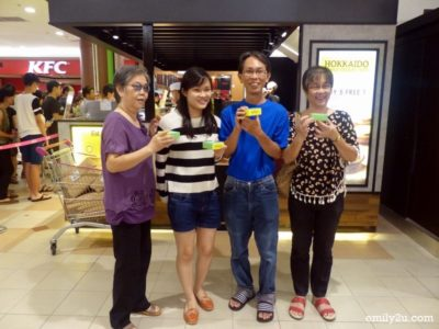 10. a smiling family with their redemption of Hokkaido baked cheese tarts