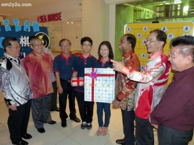 13. Dato' Seri Zambry is presented with a gift of a weiqi board