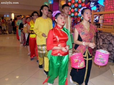 14. dressed in traditional costumes of the various races of Malaysians, carrying lanterns to celebrate Mid-Autumn Festival