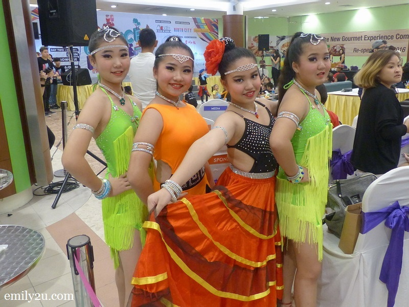 10. young Latin dancers wait for their turn on the stage
