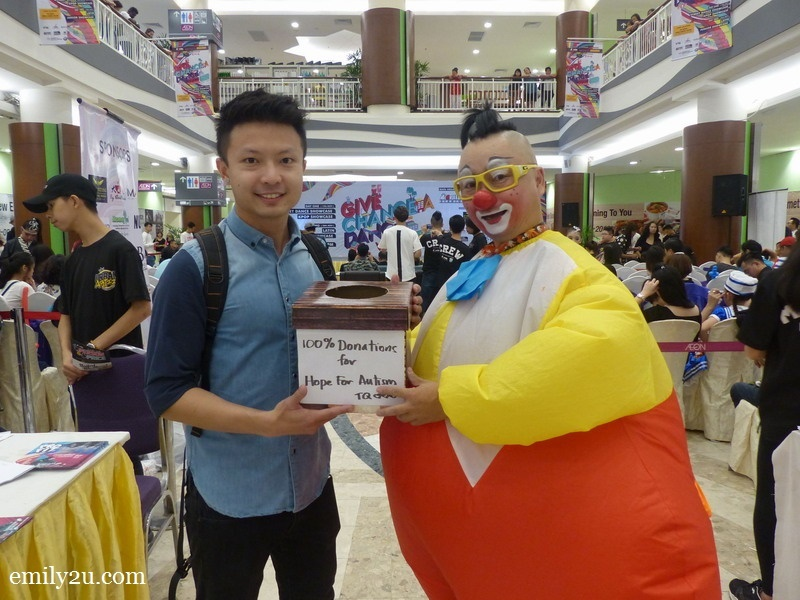 12. Au Young the Clown donates his takings to a representative from Hope For Autism Society