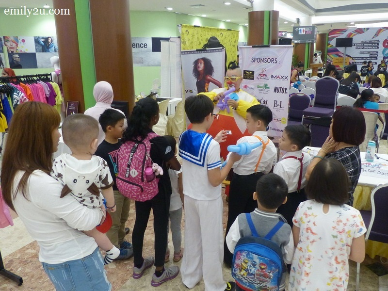 2. Au Young the Clown is a big hit with the children wherever he goes