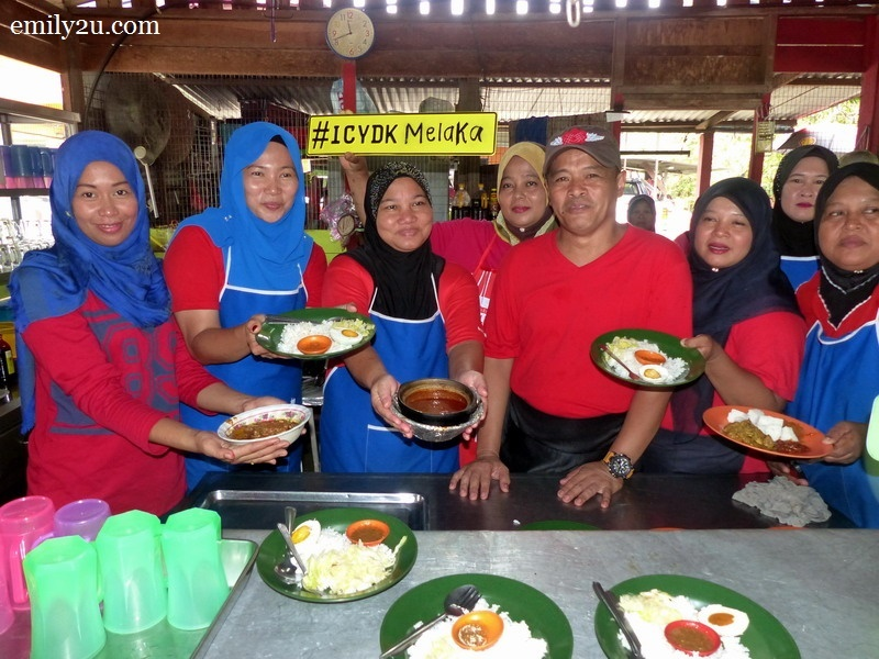 7. Yusri Nadin with his staff and food