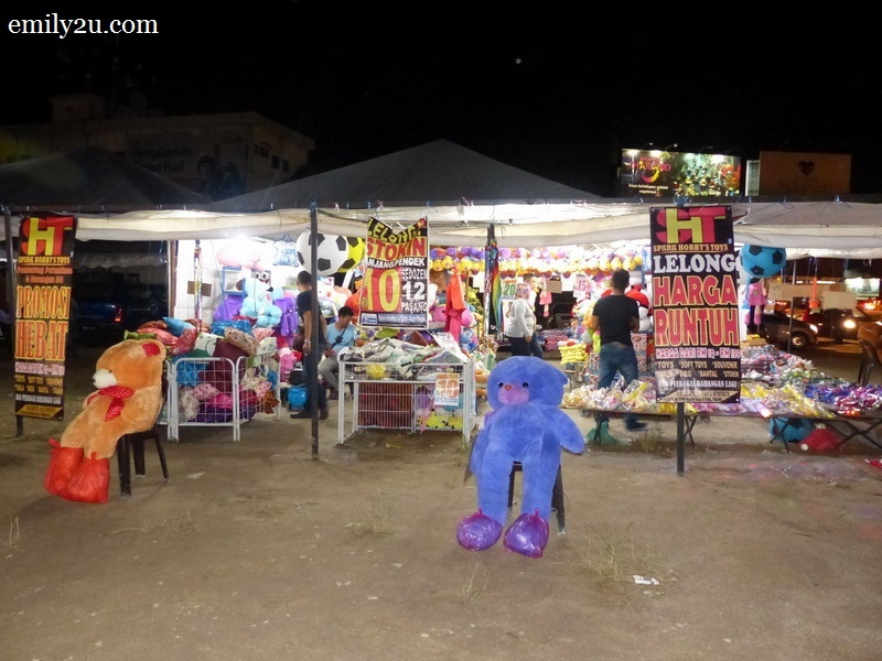 13. one of the few non-food stalls that sells children's clothes and toys