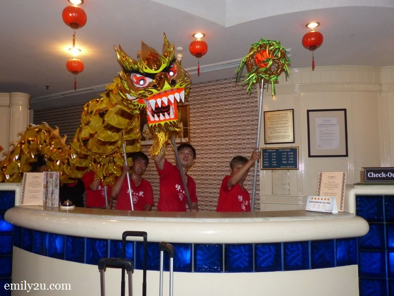 14. the dragon blesses the hotel reception counter