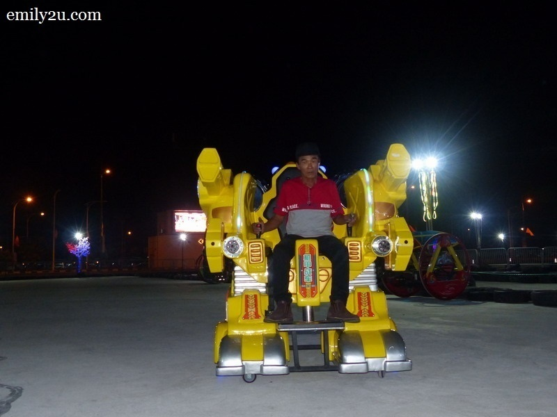 9. theme park owner, Mr. Jimmy, demonstrates the Robot