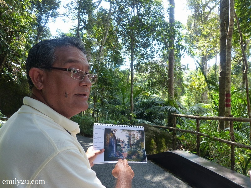 17. Operations Manager Andrew Stevenson holds a copy of the painting of the hill from years ago - the original painting is currently being displayed in Singapore