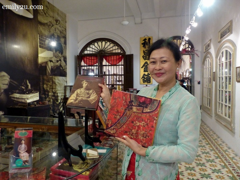 22. Nyonya Lillian Tong, Museum Director of Pinang Peranakan Mansion, with her two published books on Peranakan culture and tradition