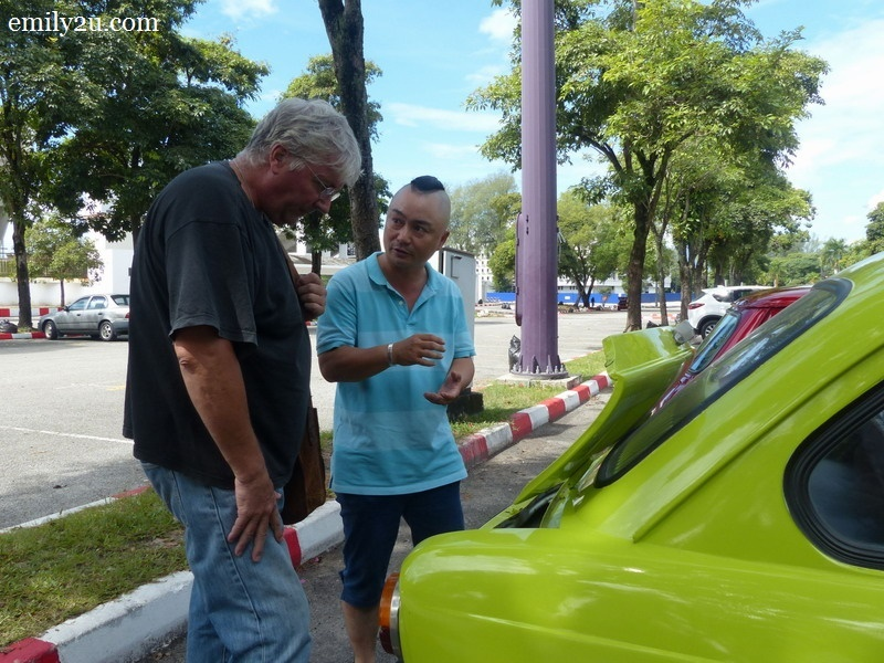 7. Au Young (in light blue top) discusses about his Fiat with a friend