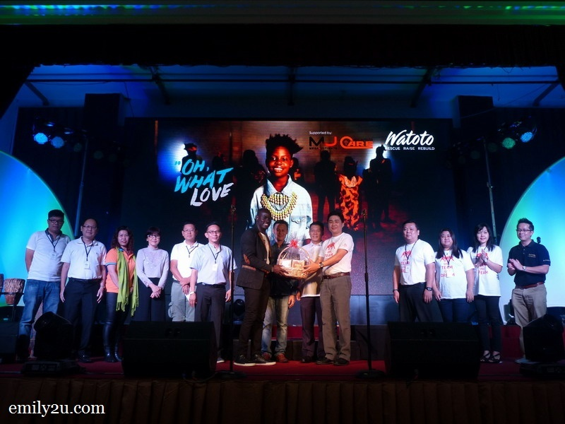 1. Ipoh organisers and sponsors present a token of appreciation to Watoto choir leader