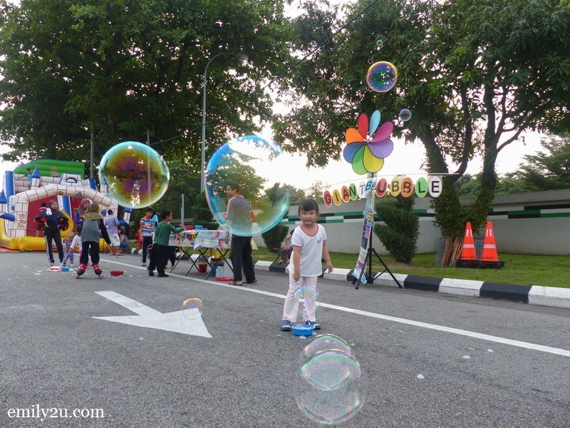 9. a kid plays giant bubbles