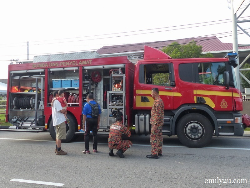 3. a young family checks out a fire engine