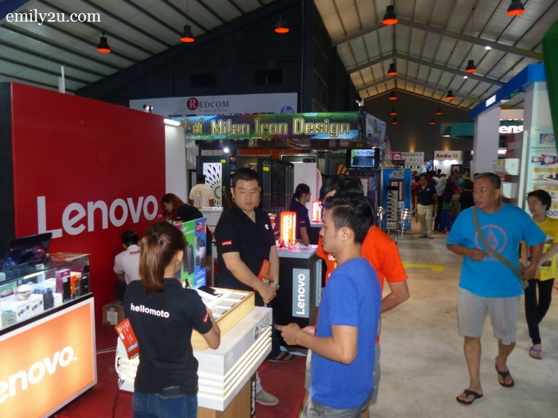 8. interested shoppers at the Lenovo booth