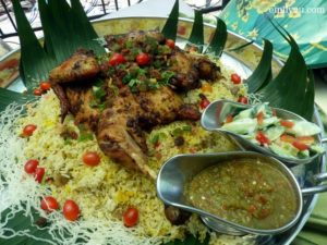 2 nasi mandy topped with chicken yoghurt