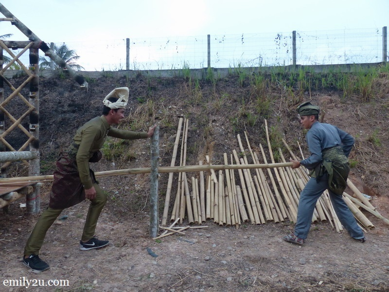 1. two 'Malay warriors' prepare bamboo for Pesta Panjut