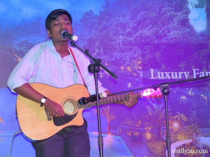 11. Muthu from Front Office serenades guests with a self-composition, specially dedicated to Mr. Peter Chan