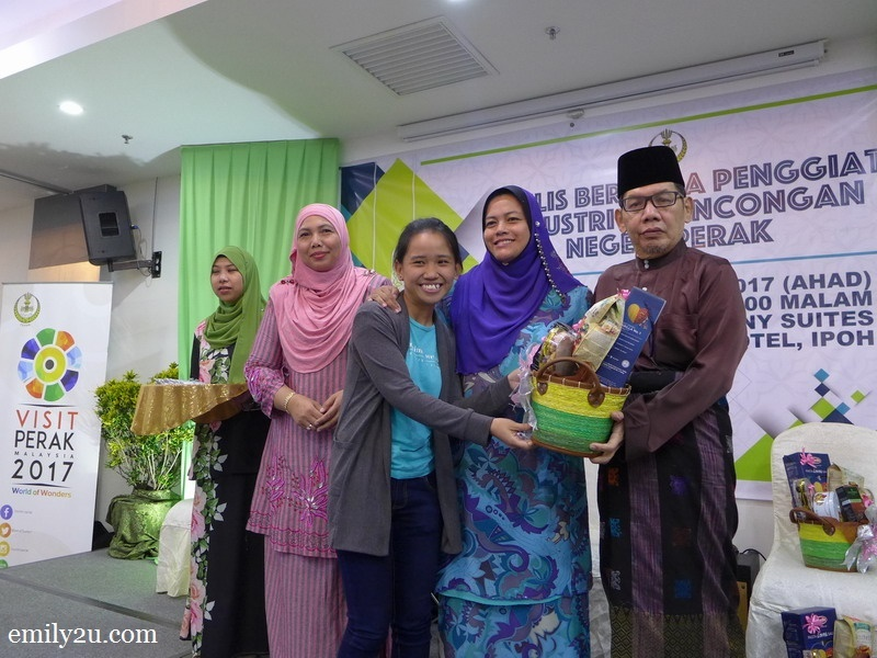3. a reporter is all smiles receiving her Hari Raya hamper