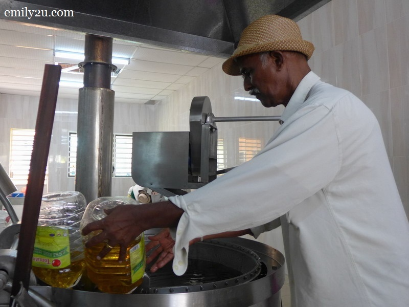 6. Jayabalan adds oil into the fryer