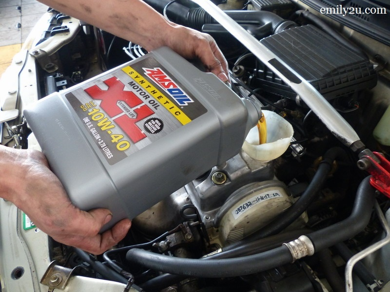 7. pour in the Amsoil 10w40 XL Series fully synthetic engine oil