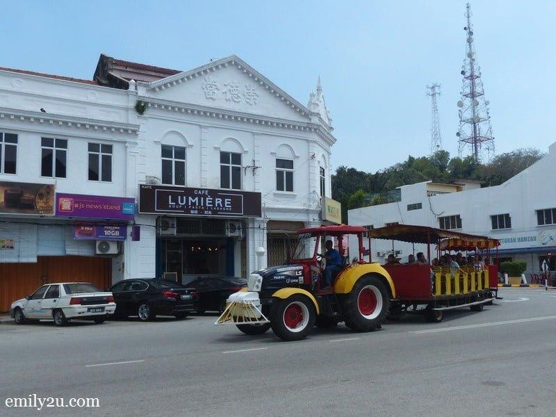 7. a Bukit Malawati tram passes by Café Lumière, Kuala Selangor
