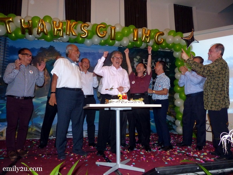 8. National University Of Singapore (NUS) Raffles Hall brothers join Mr. Peter Chan on stage to cut his birthday cake