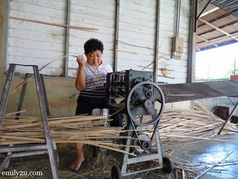1. Madam Lau Weng Thye busy shaving bamboo strips